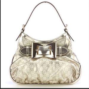 Metallic gold bow AUTHENTIC handbag